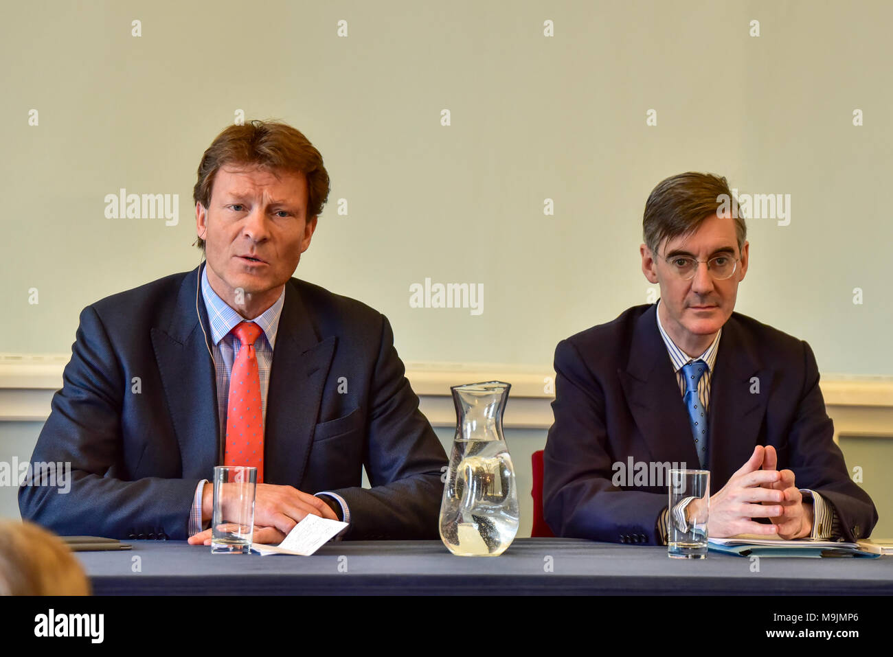 "London, United Kingdom. 27 March 2018. Jacob Rees-Mogg gives a major Brexit speech at a Leave Means Leave event in central London. Tory MP Rees-Mogg slammed Brussels for its ""bullying"" approach and said that they have entered negotiations ""in the spirit of they know best and we must do as we are told"". Pictured: Jacob Rees-Mogg & Richard Tice  Credit: Peter Manning/Alamy Live News - Stock Image"