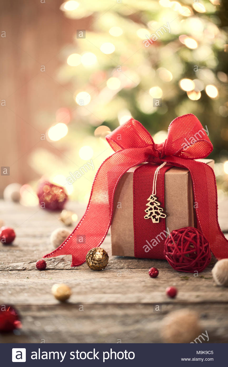 Eco environmentally friendly Christmas holiday gift on old wood table - Stock Image