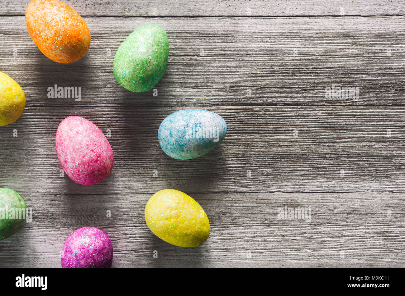 Colorful Eggs on White Rustic Table with Space for Copy - Stock Image