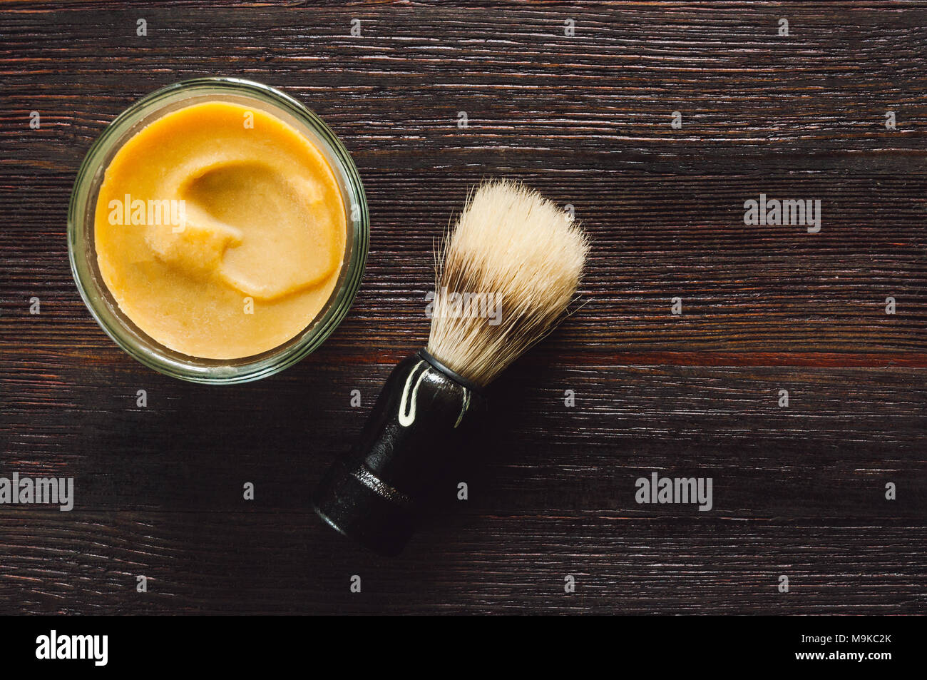 Men's Shaving Tools - Soap and Brush on Dark Table with Space for Copy - Stock Image