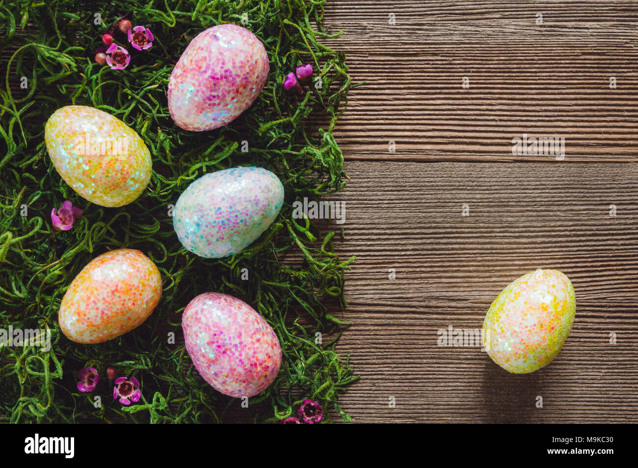 Decorated Eggs on Bed of Grass with Space for Copy - Stock Image