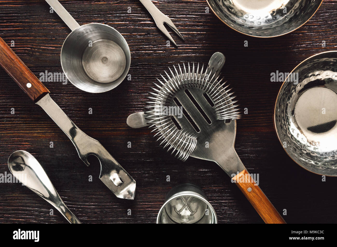 Vintage Bar Tools and Bowls Arranged on Dark Table - Stock Image