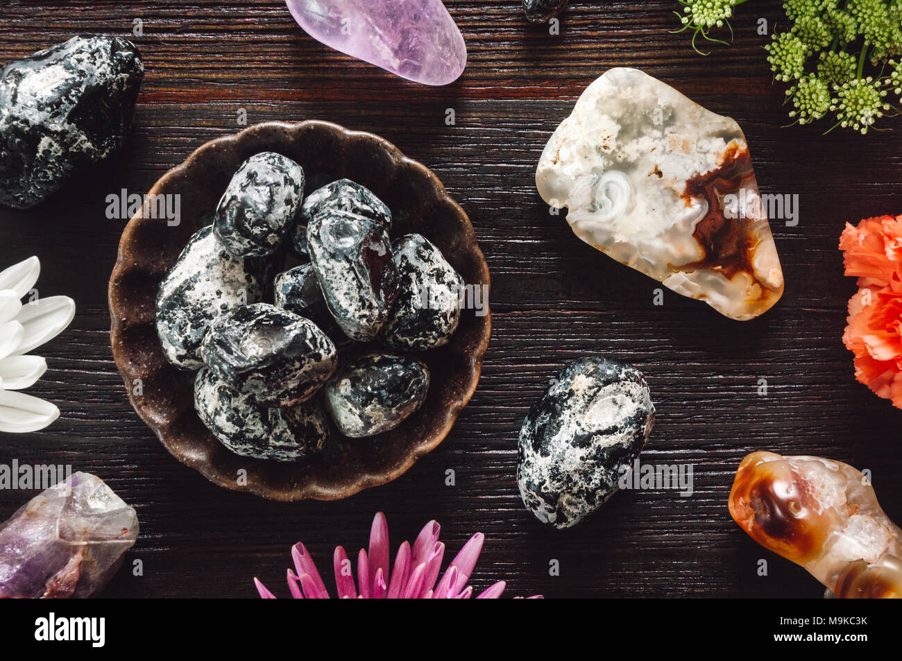 Stones of Aries including, Fire Agate, Apache Tears, and Amethyst - Stock Image