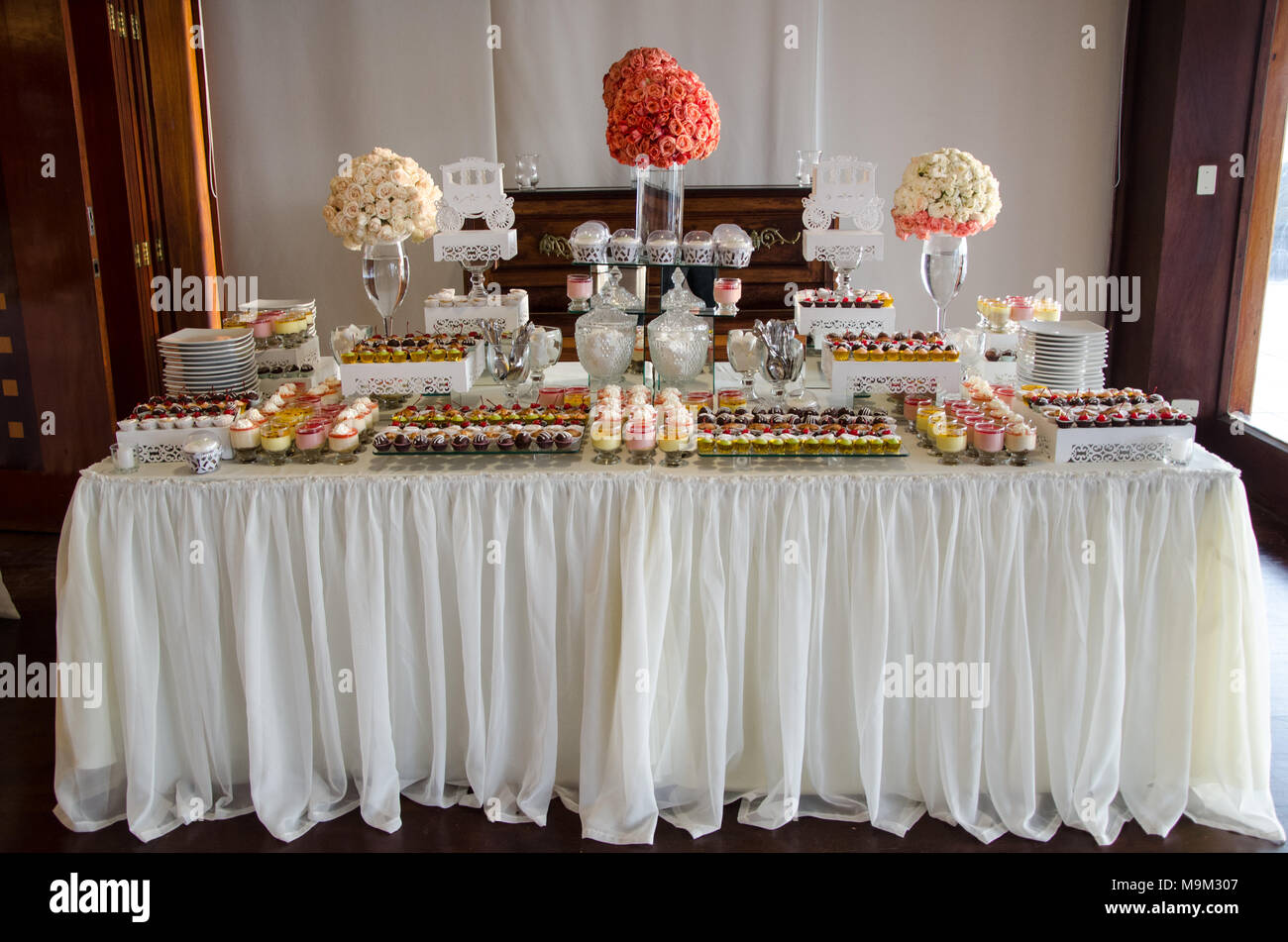 decorating a candy table at a wedding stock photo 178076983 alamy