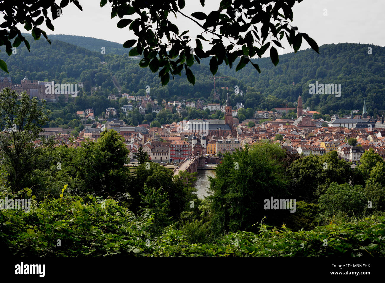 A bridge over the Neckar River in central Heidelberg as seen from the philosopher's walk. Germany. - Stock Image