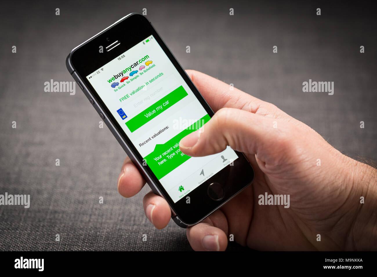 webuyanycar.com app on an iPhone - Stock Image