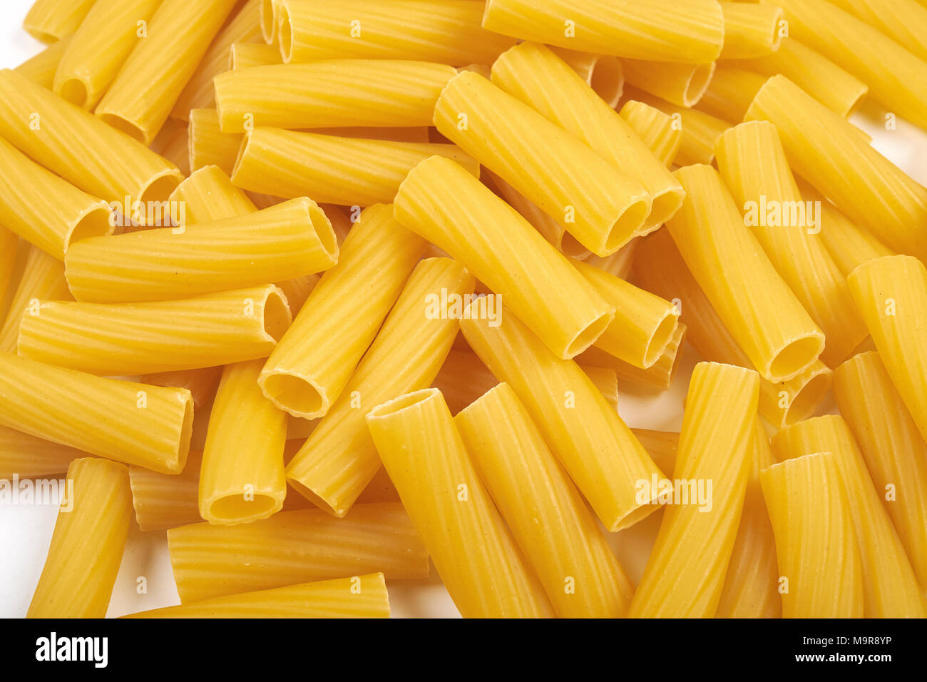 Rigatoni italian pasta isolated on white background Stock Photo
