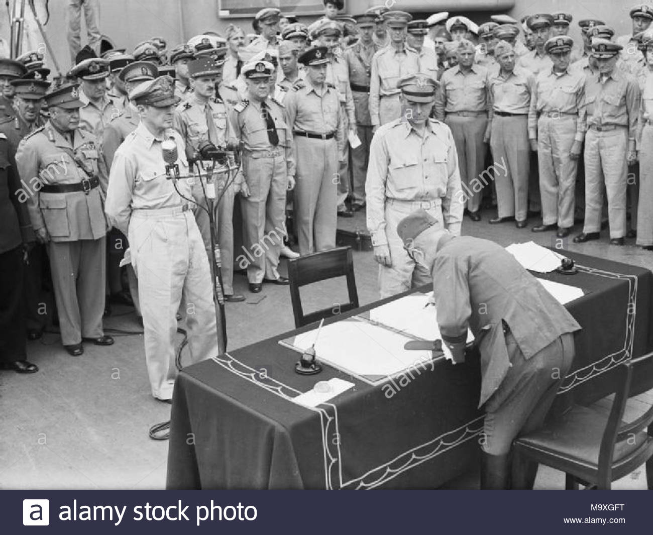 Japanese Surrender at Tokyo Bay, 2 September 1945 General Umezu Yoshijiro signs the surrender on behalf of the Imperial Japanese Army on board USS MISSOURI in Tokyo Bay. - Stock Image