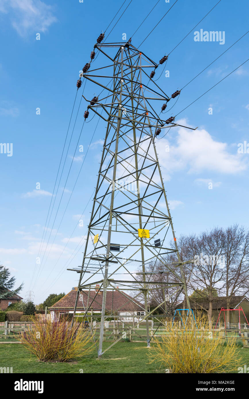 Electricity Pylon And Wires Carrying Electrical Power On The National Grid In Uk