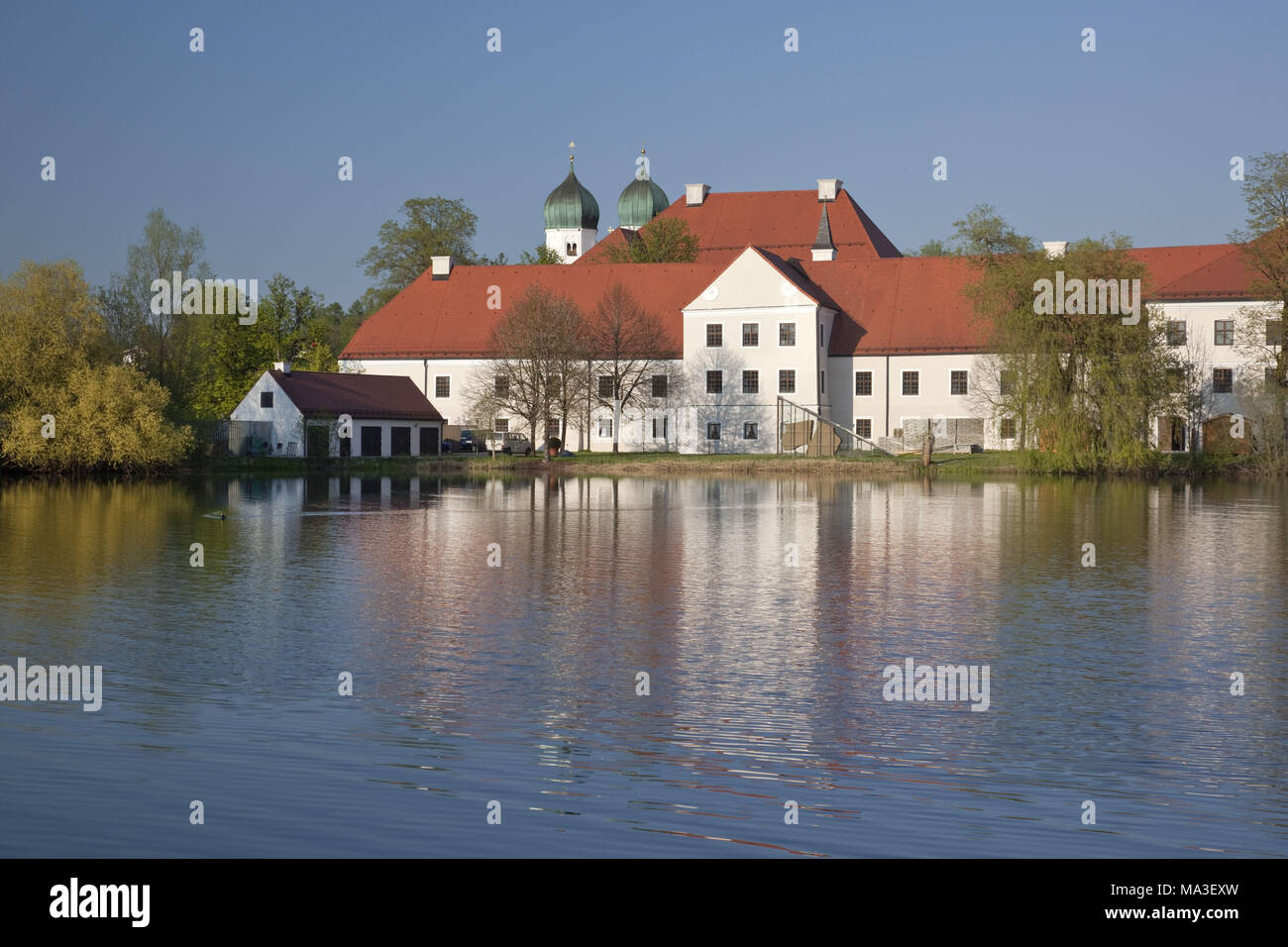 abbey of Seeon in the abbey lake, Chiemgau, Seeon-Seebruck, Upper Bavaria, Bavaria, South Germany, Germany, - Stock Image
