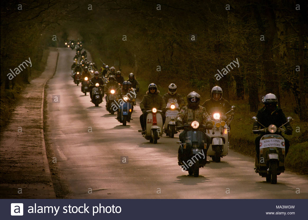 King's Lynn, Norfolk, 30th March 2018.  enthusiasts from KIng's Lynn Gladiators Scooter Club riding out in the sunshine through the back roads of Norfolk. Credit: 67photo/Alamy - Stock Image