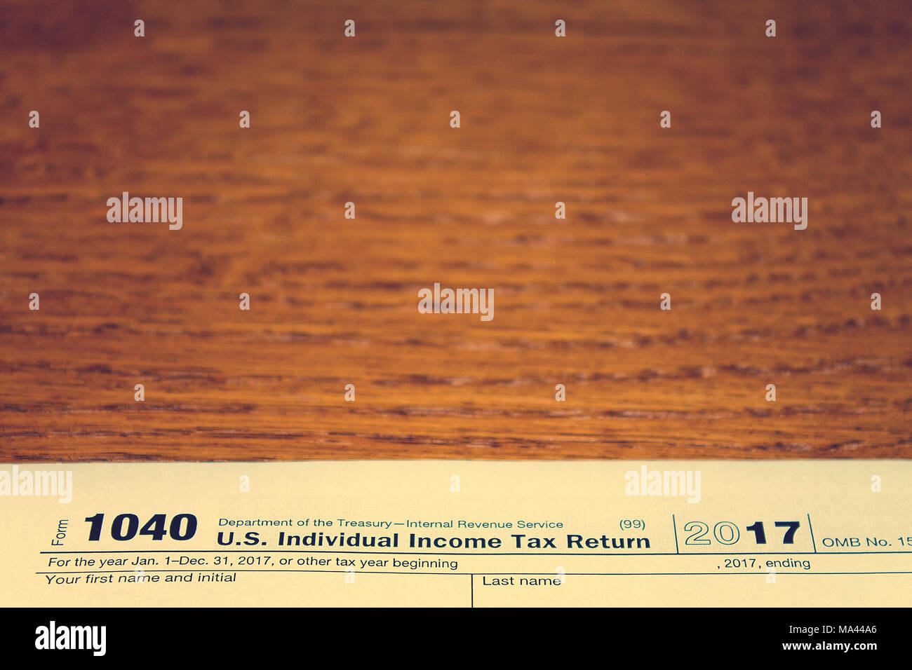 Tax Day The Tax Form 1040 Is On A Wooden Table Stock Photo