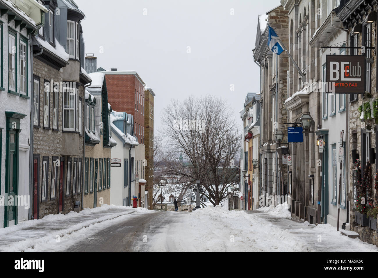 QUEBEC, CANADA - DECEMBER 27, 2016: Street of the Old Town of Quebec City covered in snow. The Vieux Quebec is one of the oldest districts of North Am - Stock Image