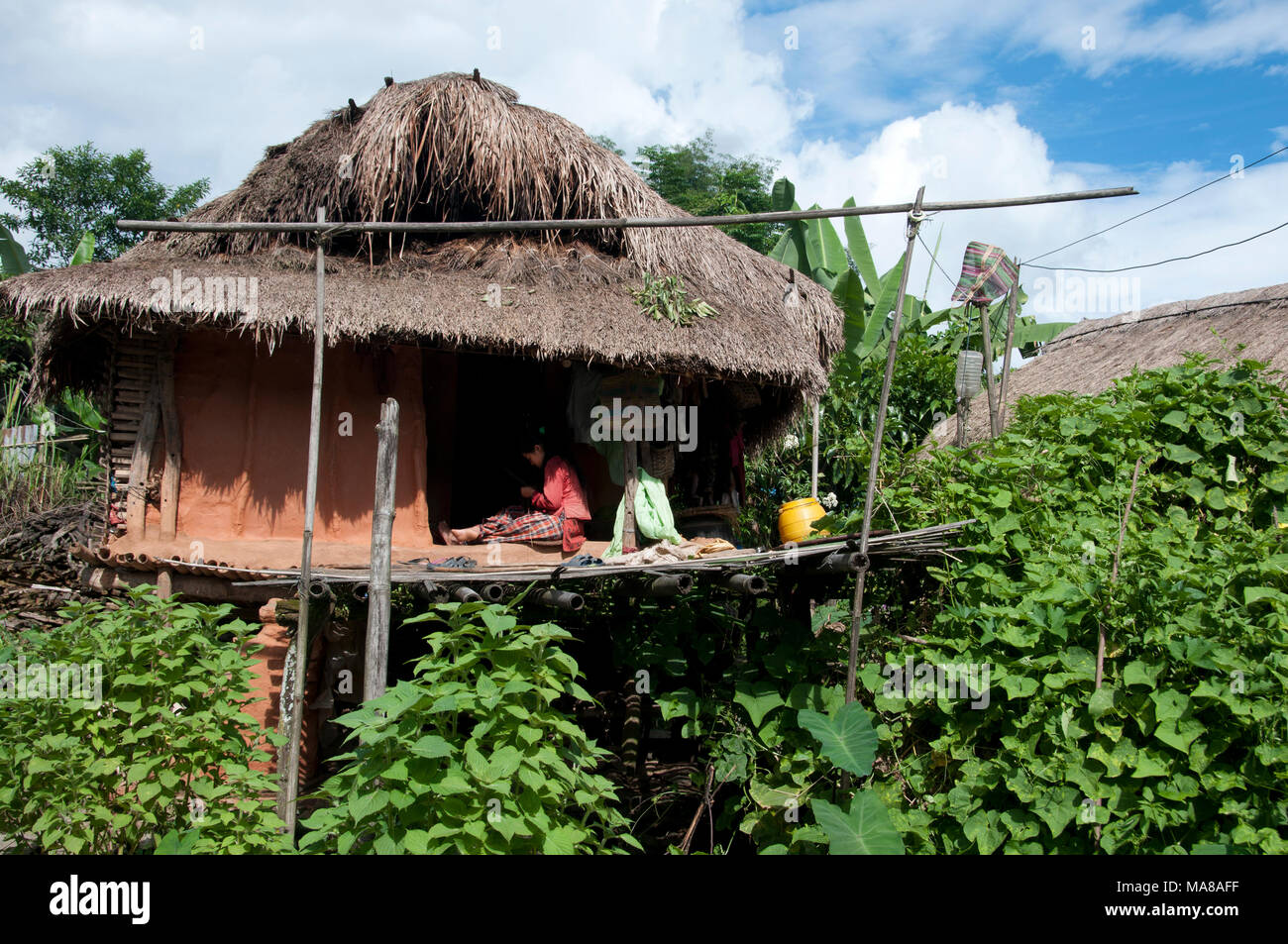 Nepal 2014. Sankhuwasabha District. Women Sitting On The Bamboo Terrace Of  A Traditional House