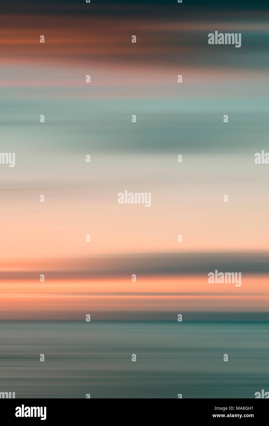 Abstract of sea and sky blurred using intentional camera movement - Stock Image
