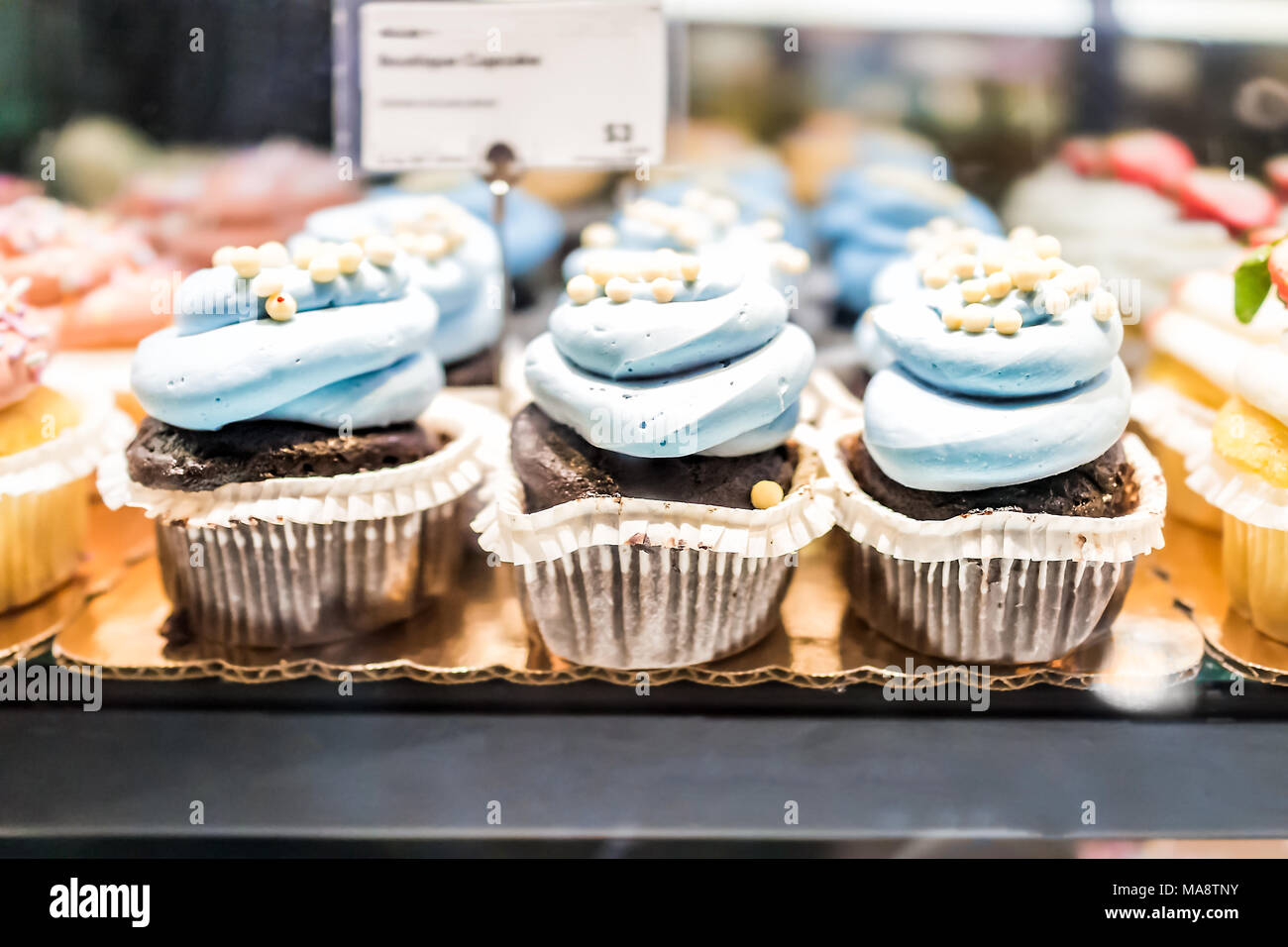 Macro Closeup Of Chocolate Cupcakes On Display In Bakery In Muffin
