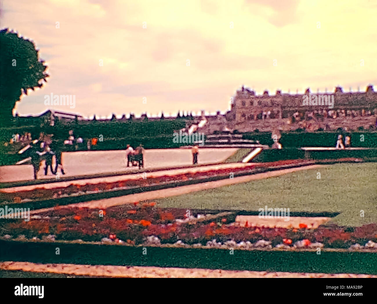 Parisian palace of Versailles in the Versailles garden from Paris in 1976. Historic archival footage in Paris city of France in 1970s. - Stock Image