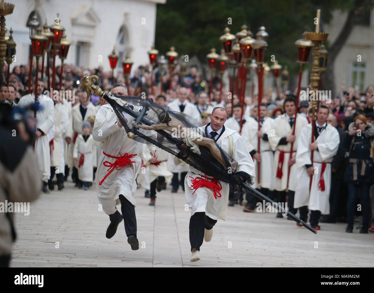 Hvar, Croatia. 30th Mar, 2018. People take part in Procession Za Krizen on the island of Hvar, Croatia, on March 30, 2018. Procession Za Krizen, known as 'following the cross', takes place before the Christian holiday of Easter. It was inscribed on the Representative List of the UNESCO's Intangible Cultural Heritage of Humanity in 2009. Credit: Ivo Cagalj/Xinhua/Alamy Live News - Stock Image