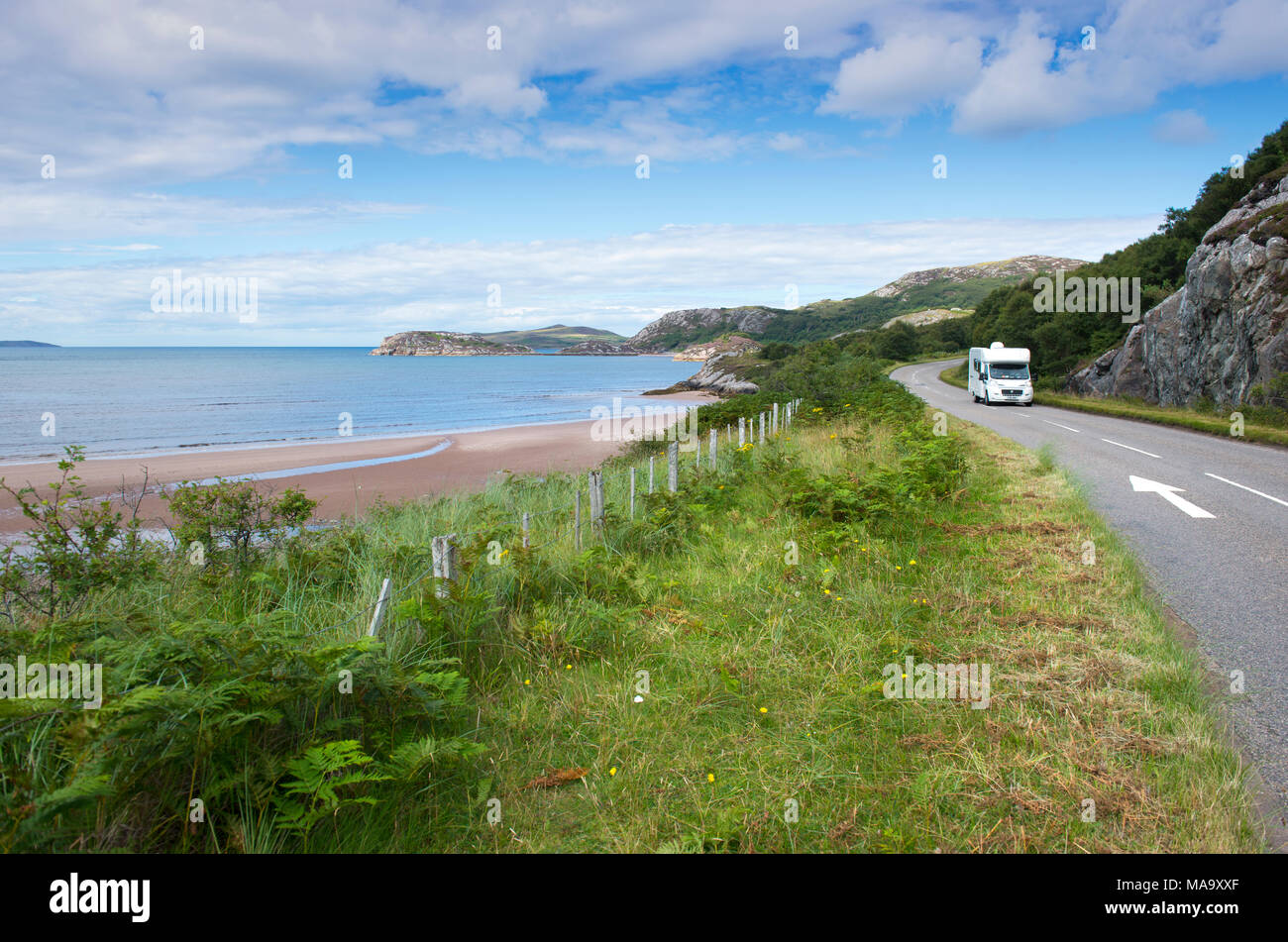 Camper van driving along the North Coast 500 scenic route in Wester Ross, Scotland - Stock Image