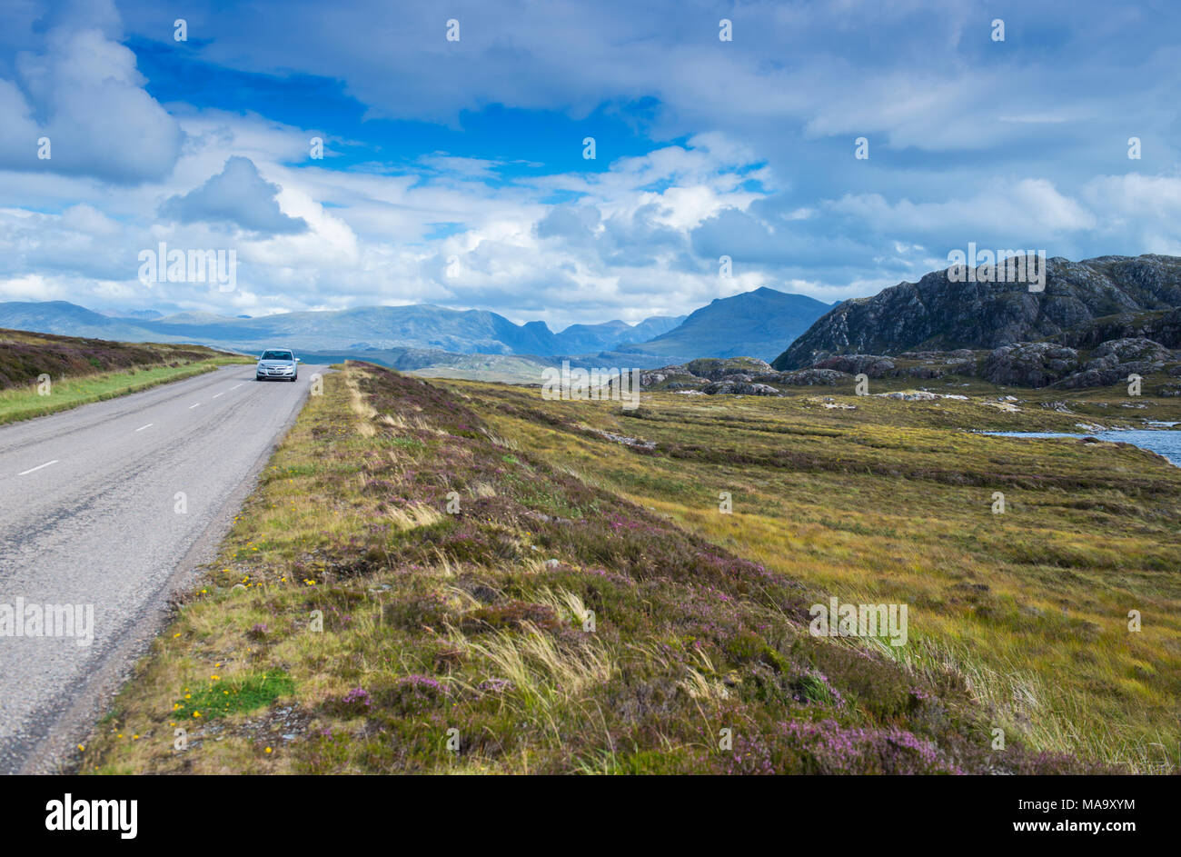 Car driving along the North Coast 500 scenic route in Wester Ross, Scotland - Stock Image