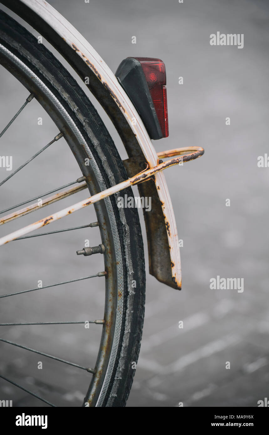 Detail of the rear wheel and rusty mud guard of an old bike - Stock Image