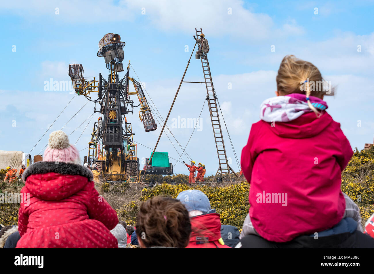 """Pendeen, Cornwall, UK. 31st March 2018. The """" Man Engine"""" at 11.2mt is the largest mechanical puppet ever constructed in Britain, he first appeared in 2016 to mark the 10th anniversary of Cornwall and West Devon Mining landscape being given World Heritage Status. Credit: Kevin Britland/Alamy Live News - Stock Image"""