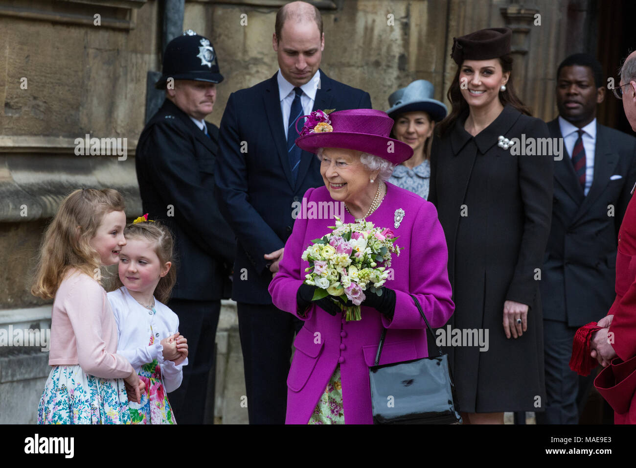 Windsor, UK. 1st April, 2018. The Queen leaves the Easter Sunday service at St George's Chapel in Windsor Castle after being presented with traditional posies of flowers by Amelia Vivian and Madeleine Carleston, both aged 6. Credit: Mark Kerrison/Alamy Live News - Stock Image