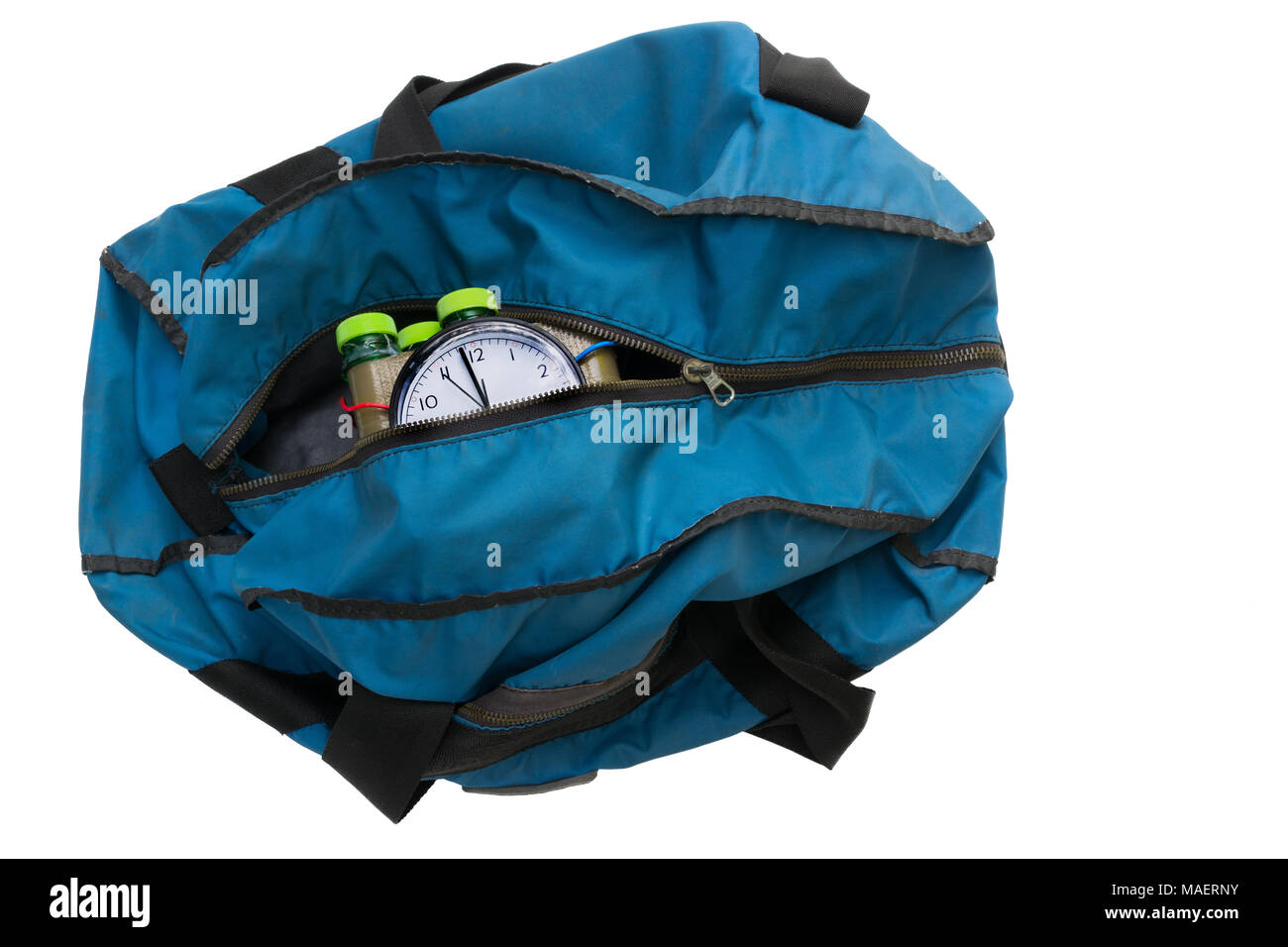 Time bomb inside blue bag. Isolated on white background. Imitation of the explosive device. Idea of weapons, terrorist attacks and violence. - Stock Image