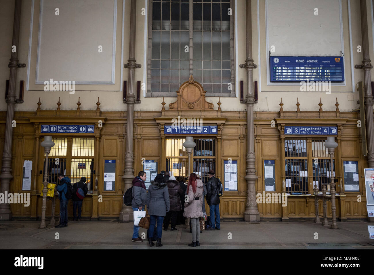 BUDAPEST, HUNGARY - DECEMBER 18, 2016: People queuing and waiting in front of ticket counters in Nyugati Palyaudvar train station to buy train tickets - Stock Image