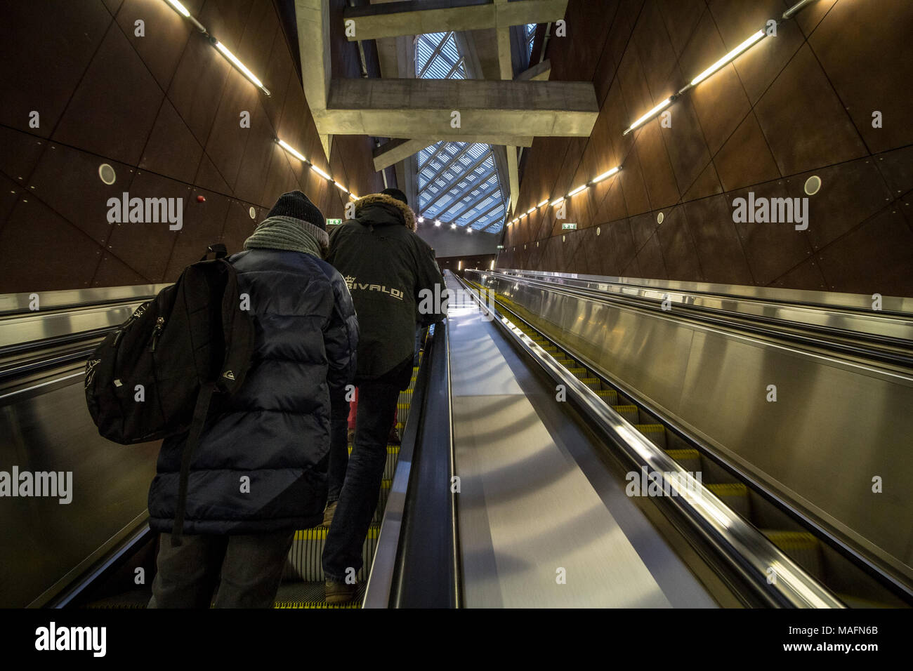 BUDAPEST, HUNGARY - DECEMBER 18, 2016: People going up a metro station of Budapest on an escalator on line 4, the most modern one of Budapest public t - Stock Image