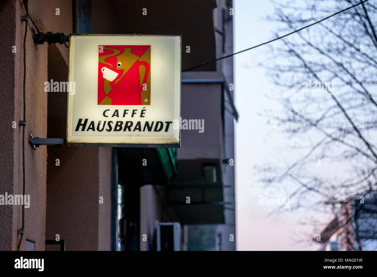 BELGRADE, SERBIA - MARCH 25, 2018: Caffe Hausbrandt logo lit on a cafe bar of Belgrade, during the evening. Caffe Hausbrandt is one of the biggest cof - Stock Image