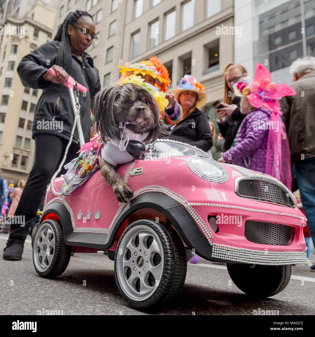 New York, United States. 01st Apr, 2018. The annual Easter Parade and Easter Bonnet Festival once again takes over a sliver of Midtow; as revelers dressed in their holiday finery (which typically includes over-the-top, often handmade hats) gather around St. Patrick's Cathedral. The tradition has remained a spring staple in the city, Easter parade attendees take the opportunity to go all-out, with creative hats (many decked out with flowers, tiny renderings of NYC landmarks, or Peeps) and other accessories now the norm. Credit: Erik McGregor/Pacific Press/Alamy Live News - Stock Image