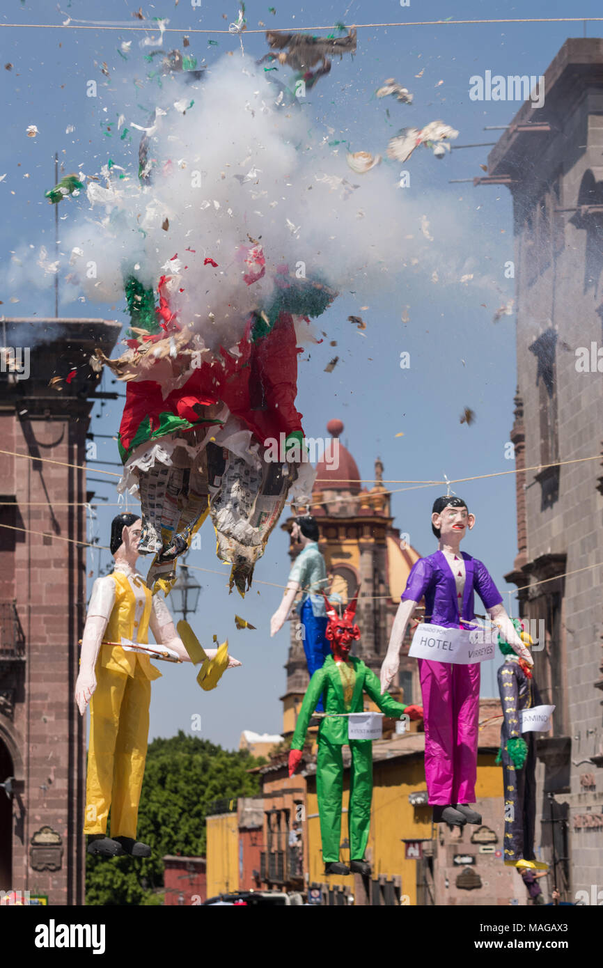 A paper doll effigy explodes during the Burning of Judas Easter-time ritual marking the end of Holy Week in the Plaza Allende April 1, 2018 in San Miguel de Allende, Mexico. - Stock Image