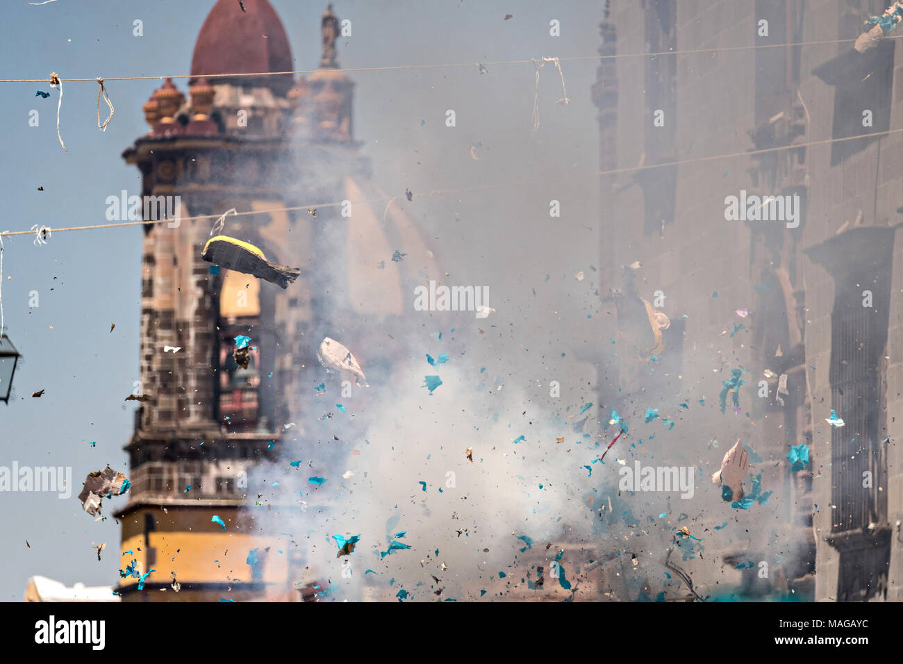 An effigy of U.S. President Donald Trump explodes during the Burning of Judas Easter-time ritual marking the end of Holy Week April 1, 2018 in San Miguel de Allende, Mexico. While the tradition includes burning a paper effigy of Judas a recent popular addition has been paper doll caricatures of Donald Trump across Mexico. - Stock Image
