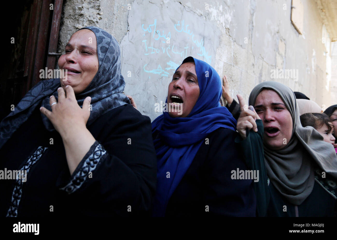 Most Inspiring Gaza Eid Al-Fitr 2018 - khan-yunis-gaza-strip-palestinian-territory-2nd-apr-2018-palestinian-women-mourn-during-the-funeral-of-faris-al-raqib-who-died-from-his-injuries-after-being-shot-in-the-stomach-by-israeli-forces-a-few-days-earlier-in-khan-yunis-in-the-southern-gaza-strip-on-april-2-2018-raqib-succumbed-to-his-wounds-three-days-after-being-shot-by-israeli-forces-when-a-mass-protest-led-to-clashes-gazas-health-ministry-said-raising-the-death-toll-credit-ashraf-amraapa-imageszuma-wirealamy-live-news-MAGJ0J  Image_366429 .jpg