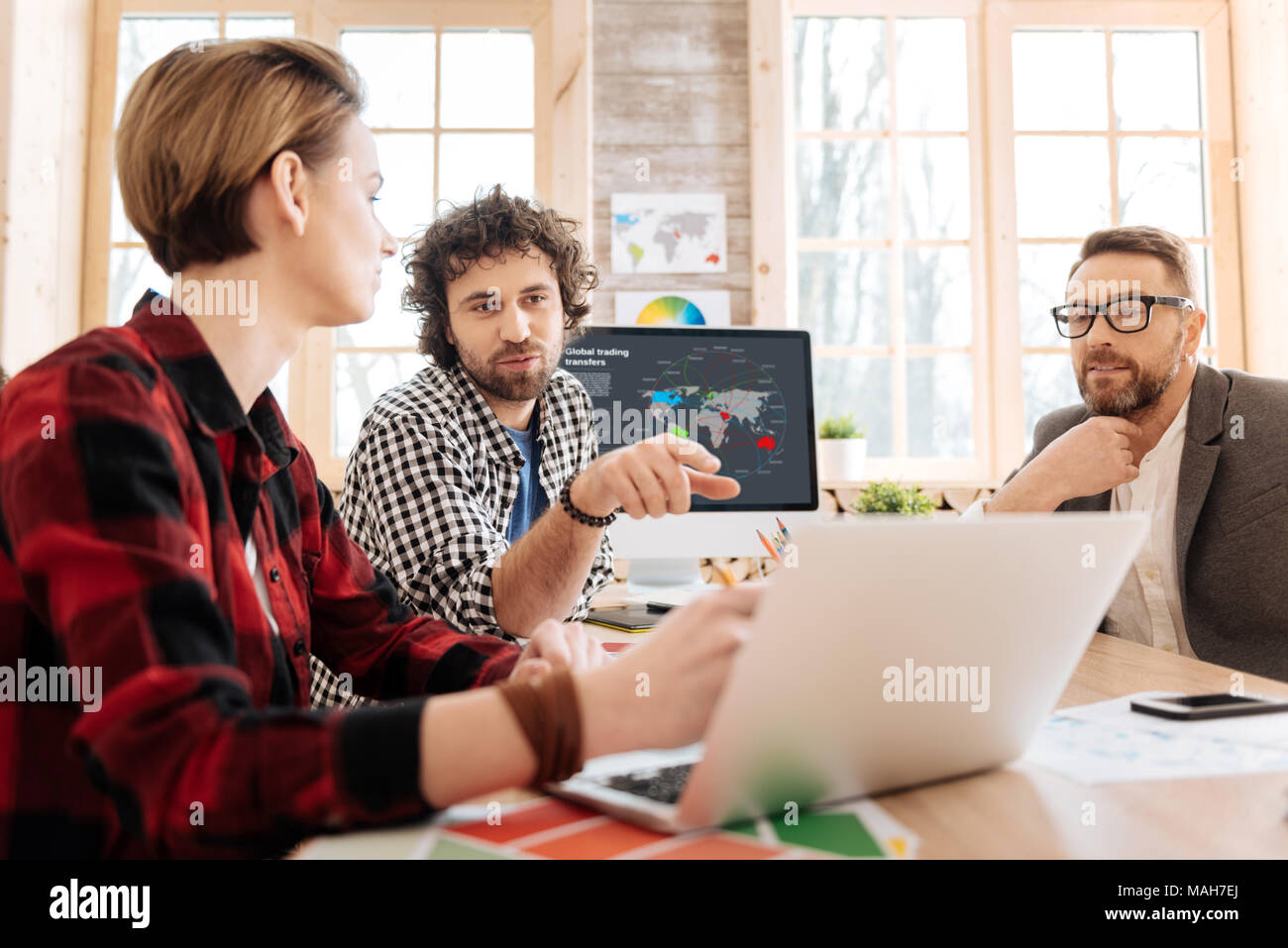 Determined man discussing work his co-workers - Stock Image