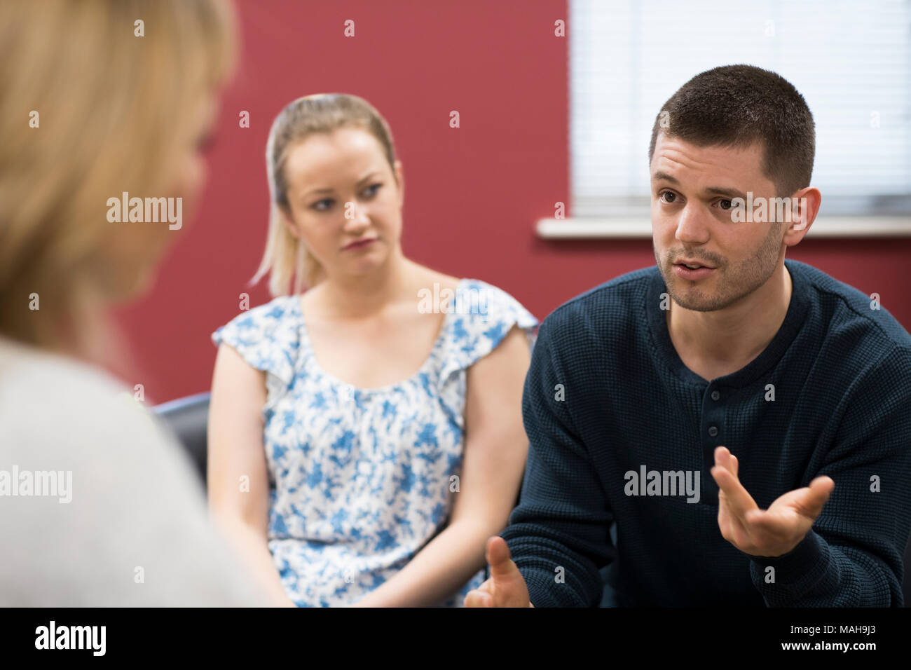 Couple Discussing Problems With Relationship Counselor Stock Photo