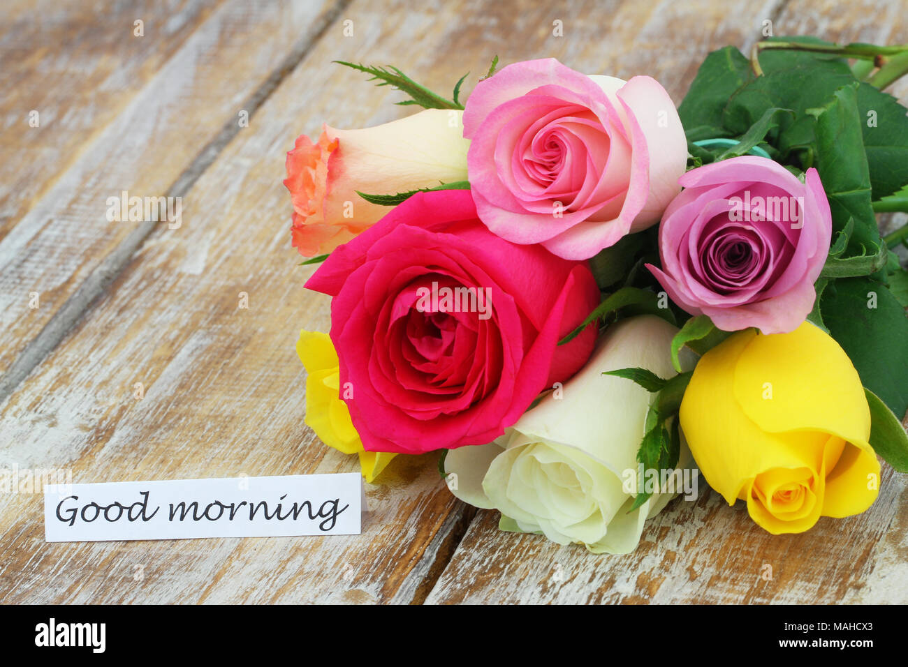 good morning card with colorful rose bouquet on rustic wooden