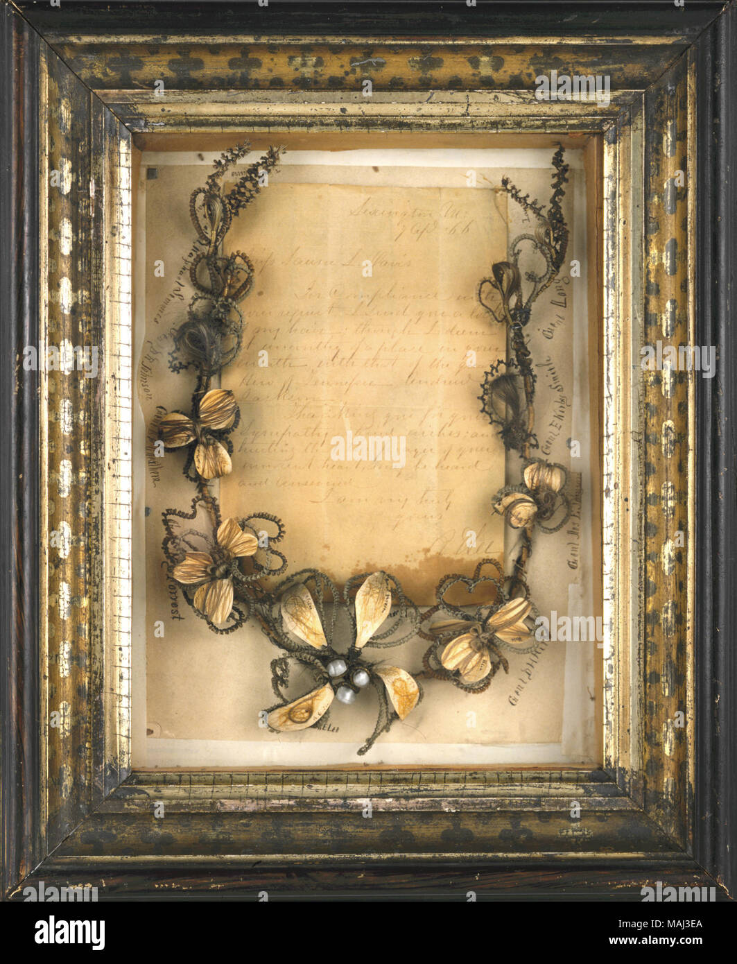 Shadow box framed hair wreath incorporating locks of hair of several ...