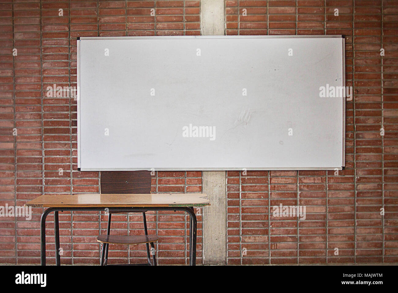 Empty Teachers Desk With Whiteboard In The Background No Teacher