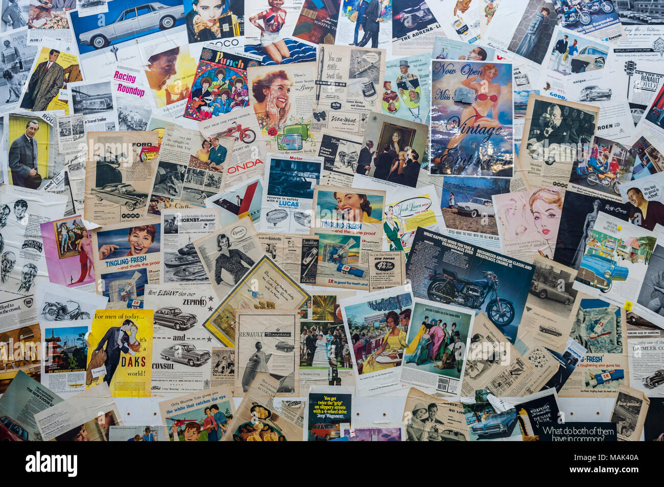 various-vintage-magazine-adverts-on-a-wall-in-coventry-market-coventry-west-midlands-uk-MAK40A.jpg
