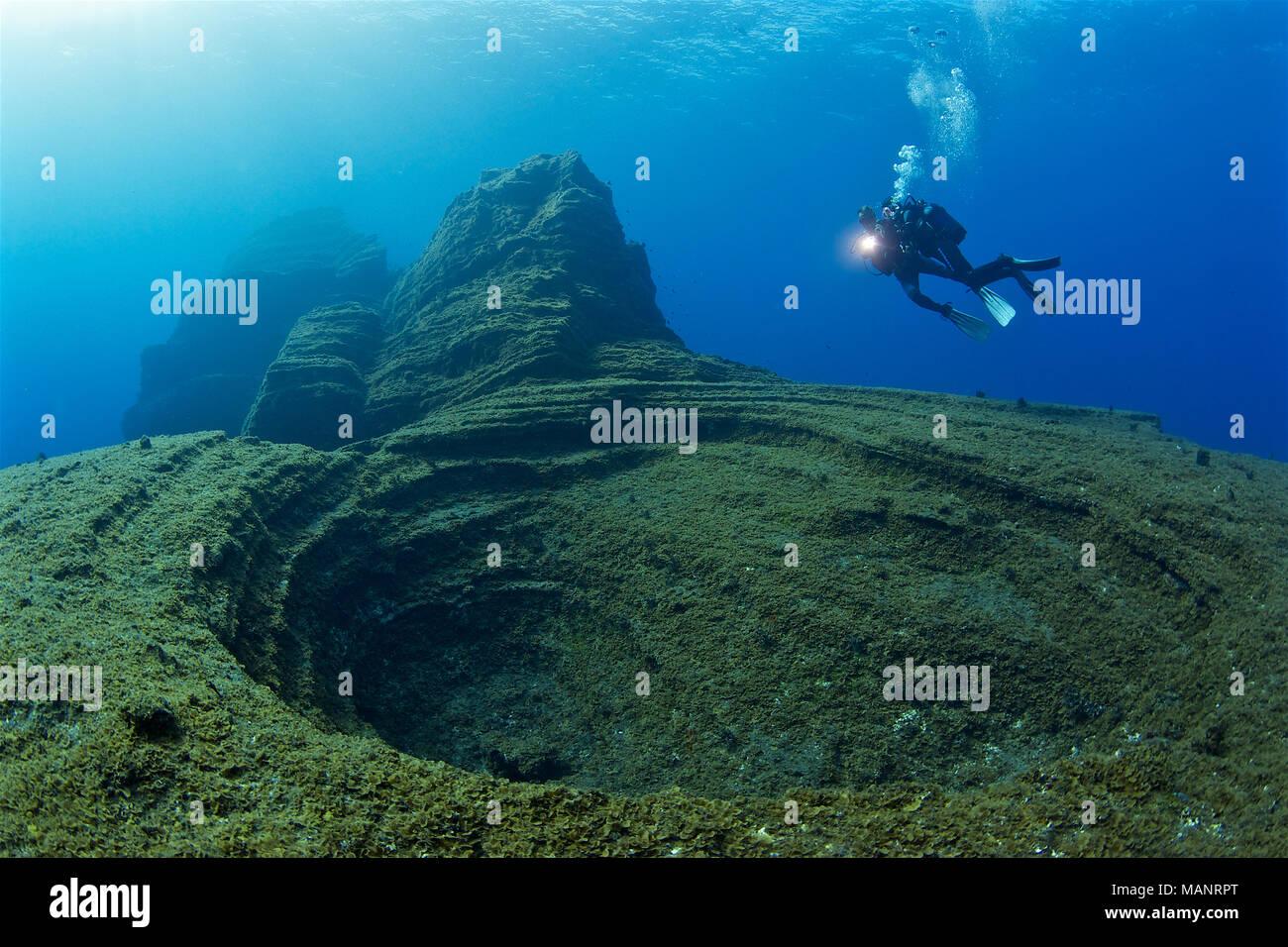 scuba-divers-at-el-bajn-dive-site-a-famo