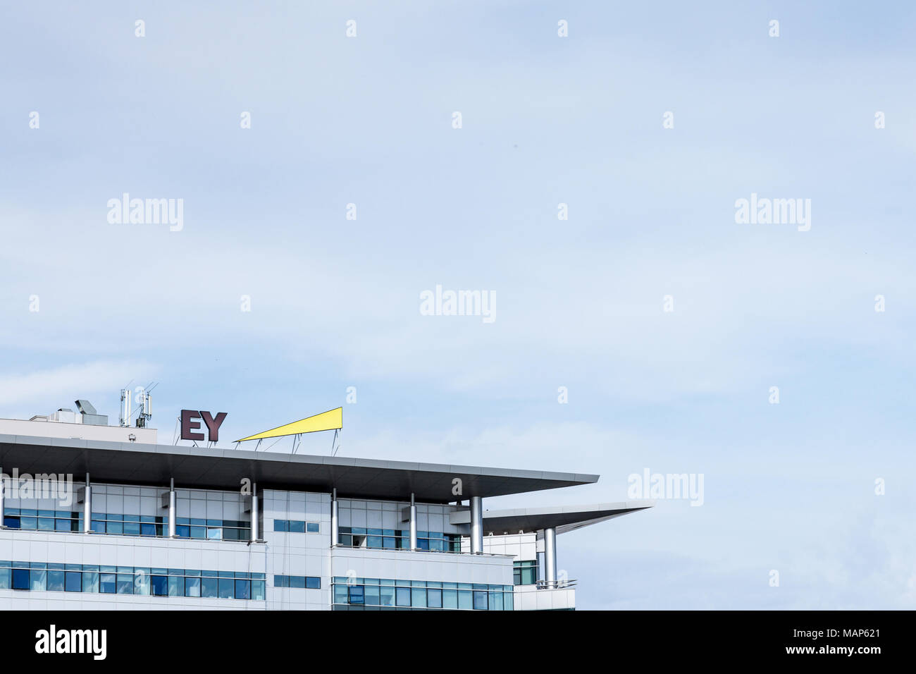 BELGRADE, SERBIA - MARCH 30, 2018: Ernst and Young (EY) logo on their main office for Serbia. EY is one of the leading companies in Business Services, - Stock Image