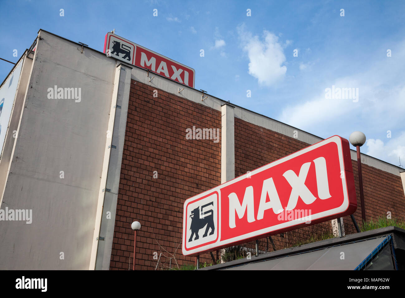BELGRADE, SERBIA - MARCH 30, 2018: Entrance of a Maxi Supermarket with its logo. Belonging to the Belgian group Delhaize, Maxi Supermarkets is the lea - Stock Image