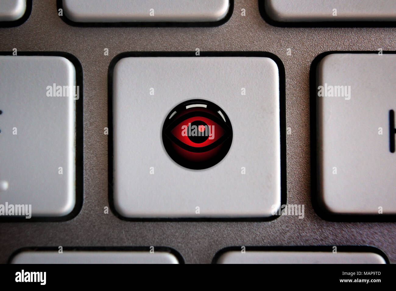 Image of eye icon on computer keyboard button - Stock Image