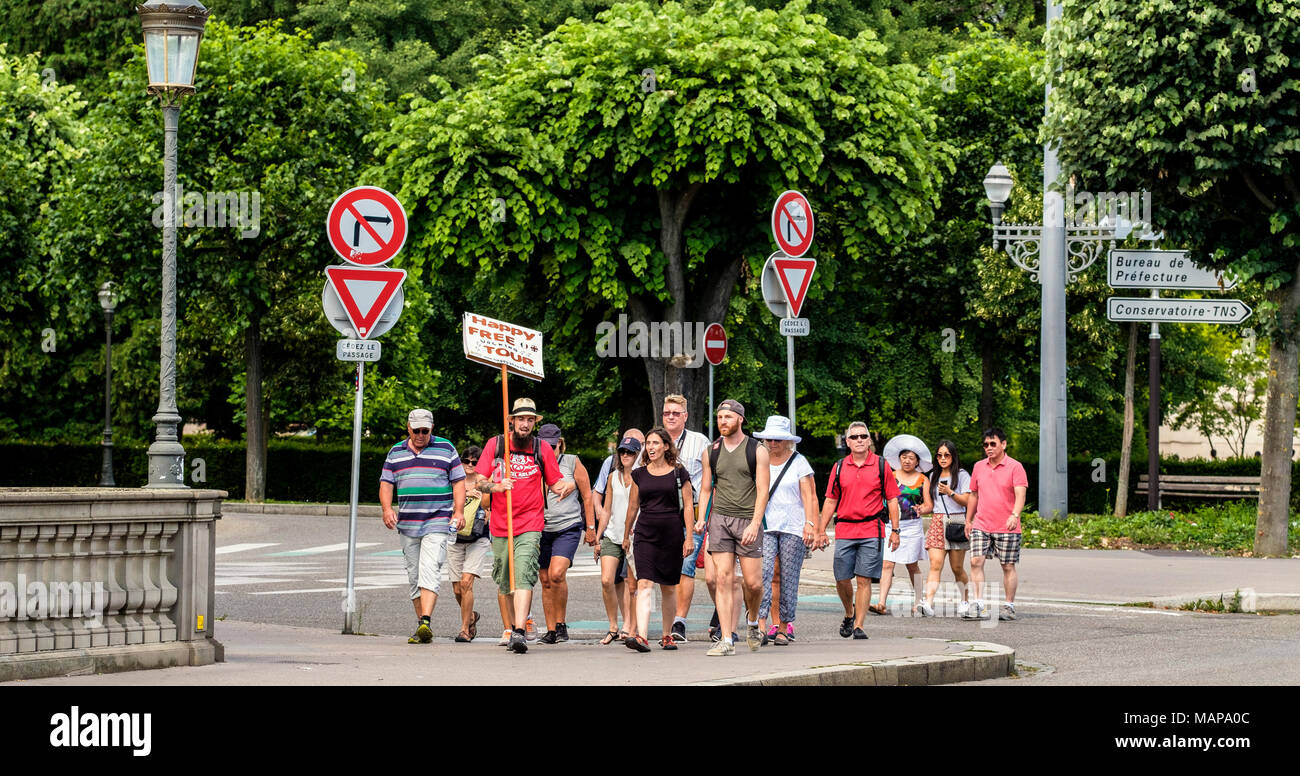 Happy free sightseeing walking guided tour tourists summer