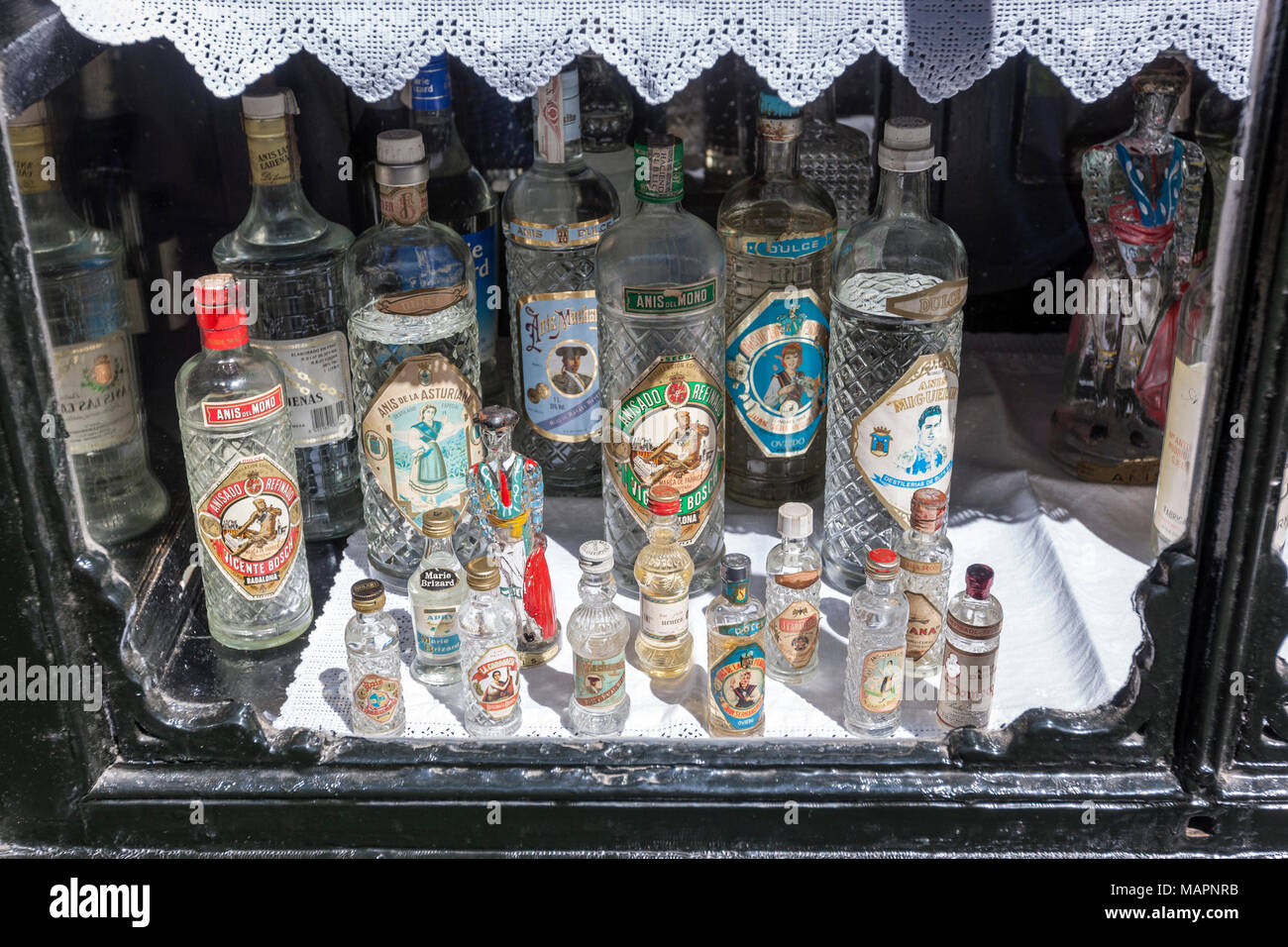 showcase-with-old-anisette-bottles-in-ho