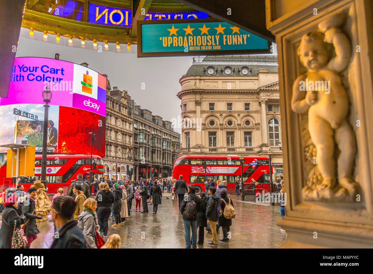 Red buses travelling through Piccadilly Circus from the Criterion Theatre, London, England, United Kingdom, Europe Stock Photo