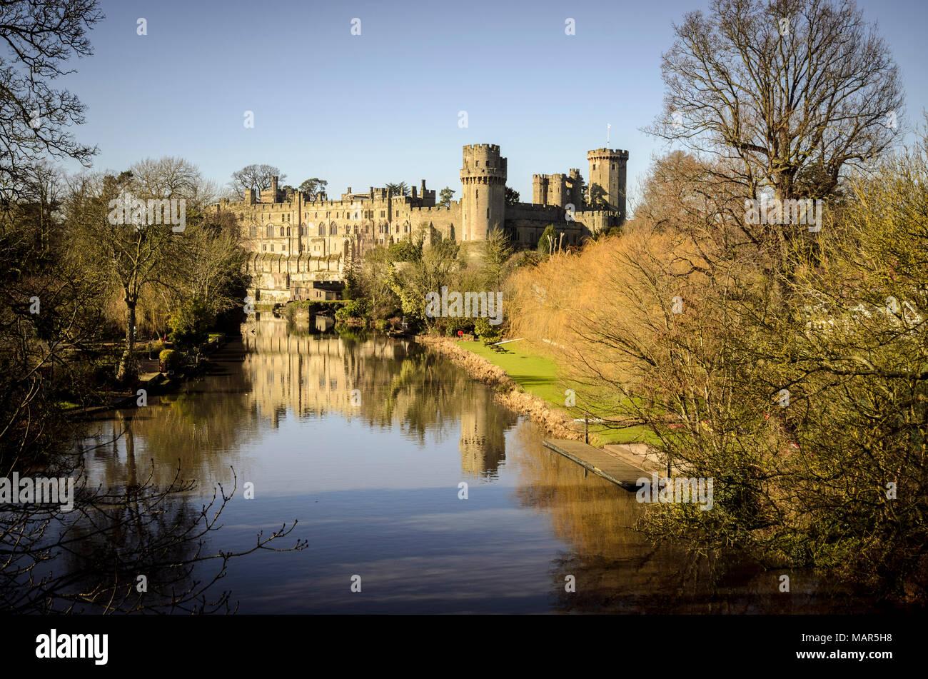 Warwick castle reflected from Banbury road bridge - Stock Image