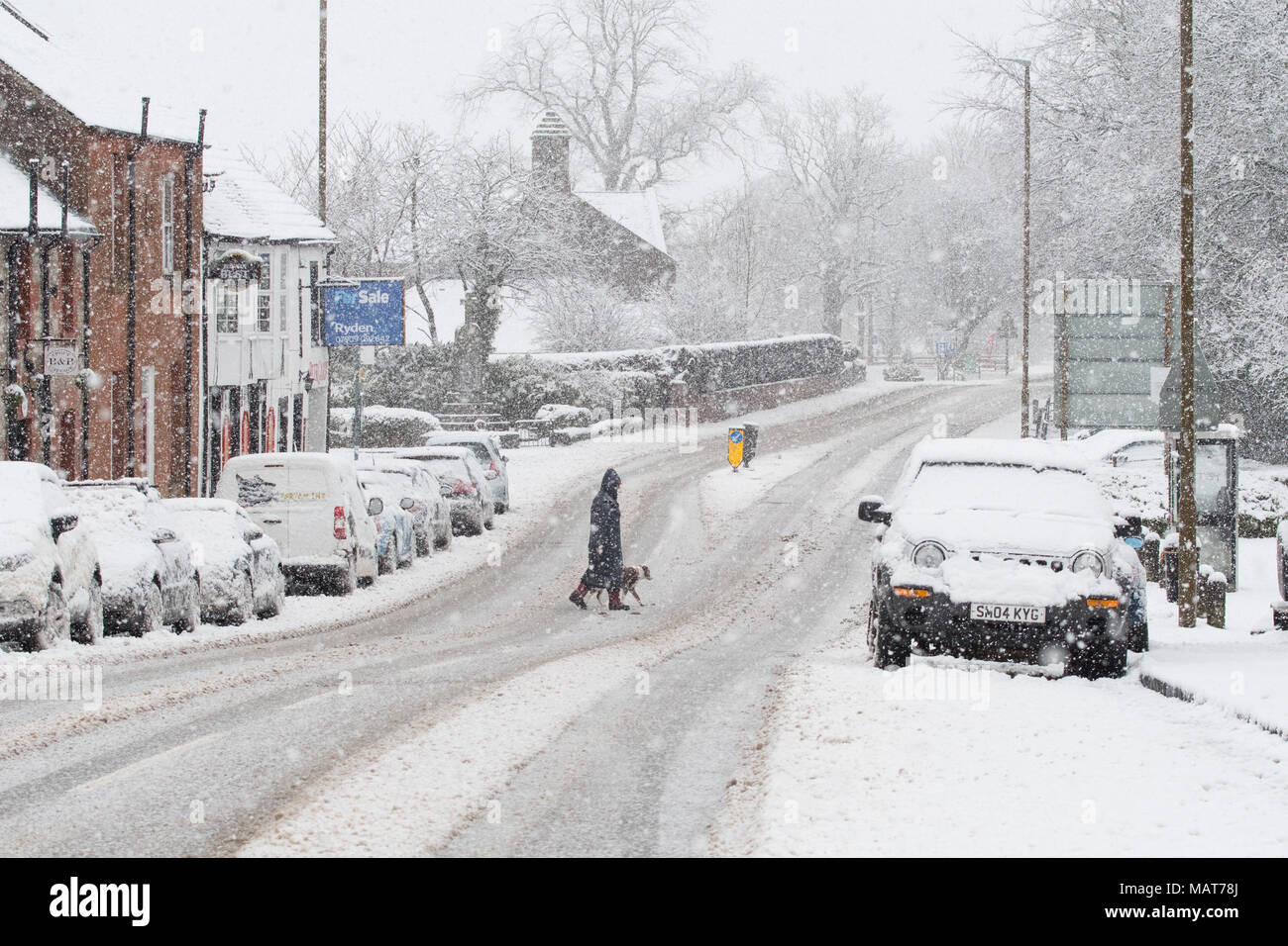 Buchlyvie, Stirling, Scotland, UK - 4 April 2018: UK weather -  heavy snow in the village of Buchlyvie on the A811 road to Stirling in Scotland's central belt Credit: Kay Roxby/Alamy Live News - Stock Image